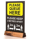 Image of 'Queue Here' Pre-printed Table Top Chalkboard